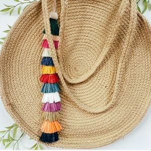 Woven round jute purse with tassel made in India